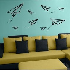 Paper airplanes over sofa