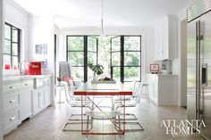 Could we fit a table for homework and breakfast in the middle and totally open up the back? The Help Author Kathryn Stockett's Atlanta Kitchen Kitchen Interior, Kitchen Design, Ikea Dining Chair, Dining Rooms, Cabinet Molding, Moulding, Kitchen Nook, Kitchen Ideas, Kitchen Floors
