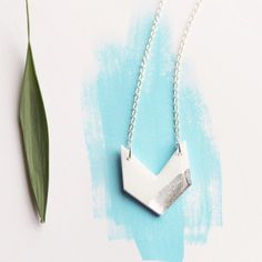 The silver dipped white acrylic chevron necklace has just been listed!