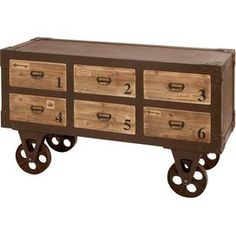 """Beech wood and metal cabinet cart with weathered details and factory-style wheels.   Product: Cabinet cartConstruction Material: Beech wood and metal alloyColor: NaturalFeatures:  Charming designWill enhance any décor  Dimensions: 29"""" H x 48"""" W x 18"""" D"""