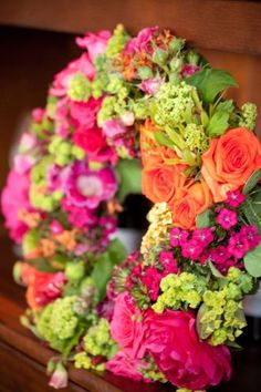 wreath with hot pink, orange and chartreuse flowers