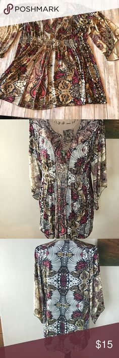 """🆕 One world tunic This top would look great with skinny jeans or leggings. Lightly used no flaws. Embellished at neck line. Bust 18"""" length 30"""" elastic at waist 18"""" ONE WORLD Tops Tunics"""
