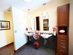 Dark floors, light walls. Wood cabinet