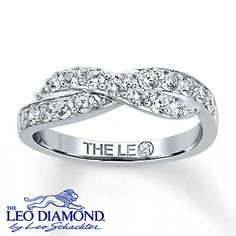 A wave of round Leo Diamonds crests over a ribbon of additional round Leo Diamonds in this magnificent anniversary band for her. Crafted of 14K white gold, the elegant ring has a total diamond weight of 3/4 carat and features independently certified diamonds. Diamond Total Carat Weight may range from .69 - .82 carats.