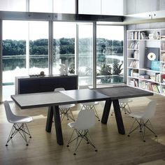 The Apex table extends to maximise a small space, and has carefully positioned and angled legs to allow the maximum amount of diners