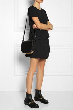 Fendi bracelet, Valentino bracelet, Theyskens' Theory skirt and t-shirt, Givenchy shoes, Alexander Wang bag.