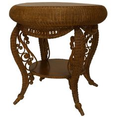 American Victorian natural wicker round oak top table with woven apron with spool trim and shaped legs with scrolls connected with a shelf (HEYWOOD-WAKEFIELD paper label) Old Wicker Chairs, Wicker Couch, Wicker Trunk, Wicker Headboard, Wicker Bedroom, Wicker Patio Furniture, Wicker Table, Wicker Baskets, Rattan