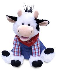 """This adorable dressed cow sings and dances to the classic song """"Old MacDonald""""."""