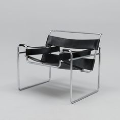 MARCEL BREUER A 1970s armchair 'Wassily'. Bent tubular steel chromed frame with black leather Uneven wear and marks on the leather. The frame tarnished. Bought at Funktio, Helsinki in 1973. bukobject