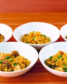 This easy version of the Spanish favorite combines chicken, sausage, and shrimp with long-grain rice, peas, and canned tomatoes. Saffron, which usually gives paella its brilliant yellow-orange hue, is replaced here by budget-friendly turmeric. This party-friendly dish can be made ahead and reheated.