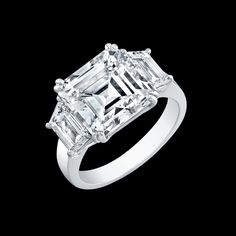 Asscher Cut Diamond Platinum Ring with Trapezoid side stones Norman Silverman Diamonds