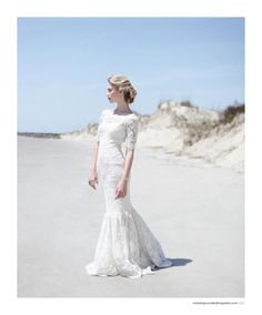 Fully embroidered corded lace gown with bateau neckline and subtle mermaid skirt.
