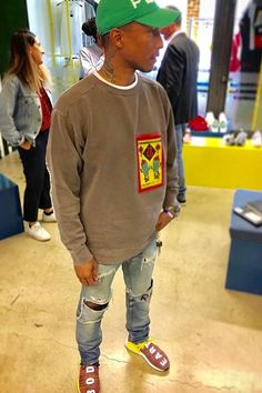 Pharrell Williams wearing Cactus Plant Flea Market Green Hat, Cactus Plant Flea Market 888 SWEATSHIRT, Adidas NMD Runners