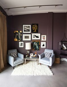 Really like everything about this... Aubergine wall colour, art, rug, 50's chairs... EVERYTHING!