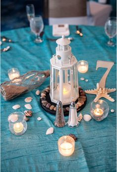 #nautical #centerpiece #lighthouse #simple #noflowers #beachwedding  #messageinabottle