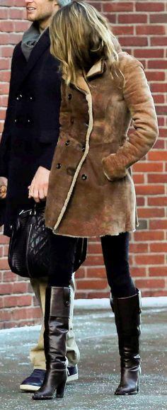 Gisele in a pretty near perfect shearling coat