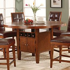 @Overstock - This modern counter-height dining room set pairs form with function. Store favorite wines in the built-in rack, and organize your table linens in the handy cupboard. The sunburst finish of the tabletop adds elegance.  http://www.overstock.com/Home-Garden/Round-Counter-Height-Dining-Table-with-Wine-Storage-Base/3416654/product.html?CID=214117 $498.99