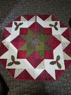 This is my version of a Christmas Tree skirt pattern from Craftsy. It is 56 wide. The blocks are 7 squares and 7 half square trangles (finished). I thought it would be too big but it was perfect Diy Christmas Tree Skirt, Xmas Tree Skirts, Christmas Tree Skirts Patterns, Big Christmas Tree, Christmas Sewing, Christmas Projects, Christmas Diy, Christmas Quilting, Crochet Christmas