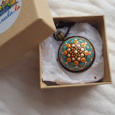 "Turquoise-orang mandala necklace ""we're back with Fabulous necklaces for sale"" #handmade #mandalas #mandalaart #handmadenecklace #mandalanecklace #mandala #handmadejewelry #handmadeaccessory #dotting #polymerclay #polymerclayjewelry #ventagejewelry #paintingmandalas #inspiredjewellery #creativejewellery"