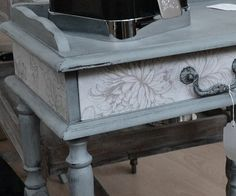 Vintage telephone table - reloved using 'troubled water' Autentico chalk paint and flowered wallpaper on the front and sides. The table has been distressed and finished with Autentico black wax to create an aged look. Complete transformation!