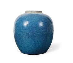 A ROBIN'S EGG GLAZE JAR of globular form with an allover blue speckled glaze which continues on the base, with an associated pierced hardwood cover 23cm high