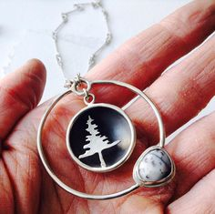 Handmade sterling silver necklace with evergreen tree and dendritic agate by Robin McGauley www.robinmcgauley.com Handmade Sterling Silver, Sterling Silver Necklaces, Dendritic Agate, Alex And Ani Charms, Handmade Jewelry, Charmed, Evergreen, Bracelets, Robin