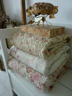 Beautifully faded soft old quilts...