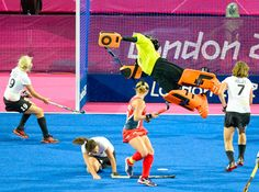 Nice try - United States goalie Amy Swensen is unable to make a diving stop on a goal by Germany in the first half of the Olympic field hockey game Sunday at Riverbank Arena.  						    						 Christopher Hanewinckel - US Presswire