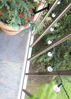 apartmentf15: balcony decor Love the idea of solar lights strung up year round