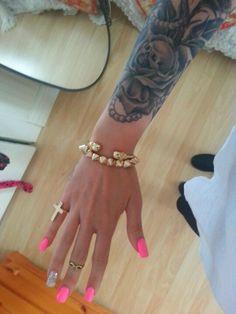 Hot pink nails and tattoos