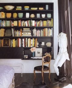 great idea for bookcase built in; bottom part folds down to make a desk; love the black too