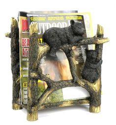 The Black Bear Magazine Stand is a great way to store your books and magazines while providing accent to your home. This magazine holder made out of resin, showcases black bear cubs climbing on the br