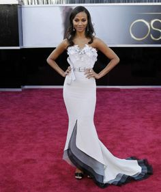 Who: Zoe Saldana Where:At the 85th Annual Academy awards held in Los Angeles Wearing: An off-white strapless Alexis Mabille Couture belted gown featuring an embellished floral appliqué bustier and a layered grey and black train from the spring/summer 2013 collection, teamed with black velvet Roger Vivier Smokingsandals and Neil Lane jewellery Verdict: Wow, wow, wow. What a gown!!! Sometimes you expect greatness and wow moments from nominee actresses but I suppose there is less pressure on…