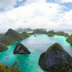 Wayag island, Indonesia. Wayag Island is one of the islands within the Raja Ampat district in the province of West Papua. The island is known for its beautiful atolls and amazing underwater life.