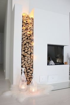 This is such a neat idea! With such a modern design, it for sure makes the house warm and cozy with adding a stacked display of wood for the fire place!