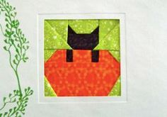 Free pattern: Cat in pumpkin quilt block · Quilting | CraftGossip.com. Would be cute to do rows of scrappy pumpkins with one or two with a cat in them.