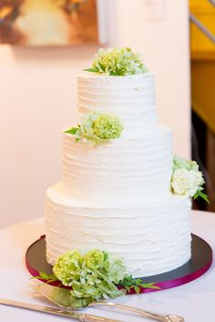 Simple white buttercream wedding cake with textured frosting topped with fresh green hydrangea | Backyard Style Eclectic Modern Wedding At Sausalito  Backyard Style Eclectic Modern Wedding At Sausalito's Studio 333 | Photograph by Robin Jolin Photography  http://storyboardwedding.com/backyard-eclectic-modern-wedding-sausalito-studio-333/