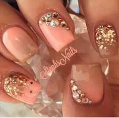 Coral sparkle and rhinestone nail design
