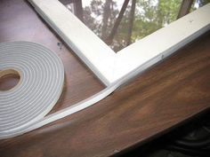 Attach foam weatherstripping around the frame to seal against the window opening and to hold the storm window in place. Here, two thin strips are being used. Interior Storm Windows, Diy Craft Projects, Project Ideas, Crafts, Home Repairs, Window Cleaner, Home Reno, Window Design, Home Improvement