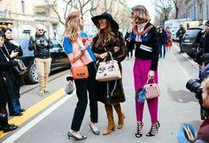 Chiara Ferragni with a Fendi top and bag, Anna Dello Russo with a Fendi bag and Saint Laurent boots, and Candela Novembre with a Fendi coat and bag
