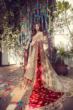 Top Pakistani Bridal Designers And Their Festive Wear Cost Gold bridal lehenga with maroon dupatta. Asian Bridal Wear, Asian Bridal Dresses, Pakistani Wedding Outfits, Indian Bridal Outfits, Pakistani Bridal Dresses, Pakistani Wedding Dresses, Bridal Dress Indian, Dress Wedding, Indian Wedding Sarees