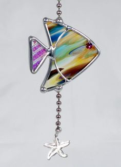 stained glass fish, light or fan pull Stained Glass Ornaments, Stained Glass Birds, Stained Glass Suncatchers, Stained Glass Designs, Stained Glass Projects, Stained Glass Patterns, Fused Glass, Leaded Glass, Mosaic Glass