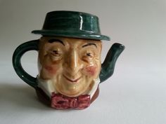 Artone Miniature Teapot Vintage Dickens Mr Micawber double faced Handpainted ARTONE POTTERY, studio pottery company was formed on the Ellgreave Pottery site which had been in existence since 1921 located in Burslem, Staffordshire District of England. Artone Pottery leased part of the facility in 1946 to the Wood family. The pottery continued until 1993 when Artone ceased to exist.  Excellent condition with no nicks, or scratches. 2 high 3 wide Non smoking pet free home.  Shipping…