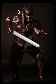 1470114a6a Woman in leather armor weilding a sword. Calimacil LARP sword   Ragnar