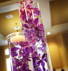 Tall cylinder vases with orchids--could do white Purple Wedding Centerpieces, Orchid Centerpieces, Wedding Vases, Wedding Flowers, Centerpiece Ideas, Wedding Decorations, Purple Centerpiece, Graduation Centerpiece, Quinceanera Centerpieces
