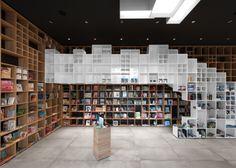 Box-like shelving covers walls in SoNo Arhitekti's Book Centre Trieste shop #book #bookcase #bookshelves