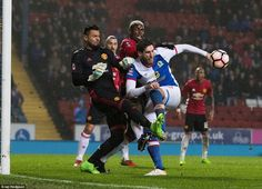 Graham and Pogba challenge for the ball while goalkeeper Sergio Romero attempts to make a clearance