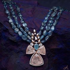 Blue gemstones woven together to arrive at a transcendent centerpiece. Recreate opulence with a blend of pastel colours and immaculate… Bridal Jewelry, Beaded Jewelry, Beaded Necklace, Gold Jewelry, Diamond Necklaces, Diamond Jewelry, Trendy Jewelry, Fashion Jewelry, Indian Jewelry Sets
