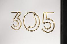 Graphics to indicate three dimensionality - structural // address signage in gold Art Deco typography Art Deco Typography, Art Deco Logo, Deco Font, Lettering, Typography Design, Hotel Signage, Wayfinding Signage, Signage Design, Environmental Graphics