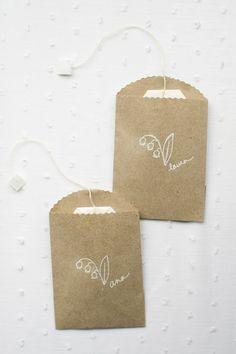 For this sweet wedding style, consider tea time favors. Mini brown bags are filled with one tea bag each, stamped and labeled with white ink. We even switched out the tags on the end to match. Just use parchment paper and some double sided tape. Your guests will adore these little favors and best of all, they'll be easy for the guests to travel with, use and recycle!